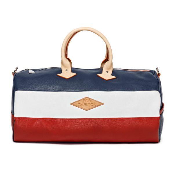 Leather travel bag grainé couleur bleu-marine, blanc et rouge, vue de face