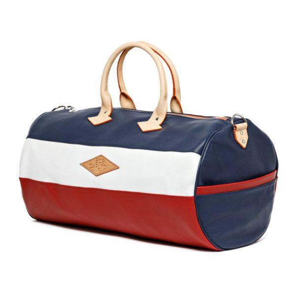 Sac de voyage cuir grainé couleur bleu-marine, blanc et rouge, vue de profil