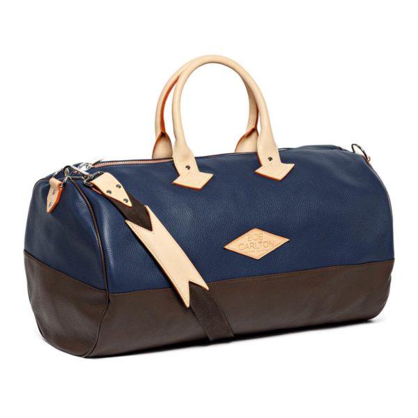 Leather travel bag color marine et chocolat bandoulière